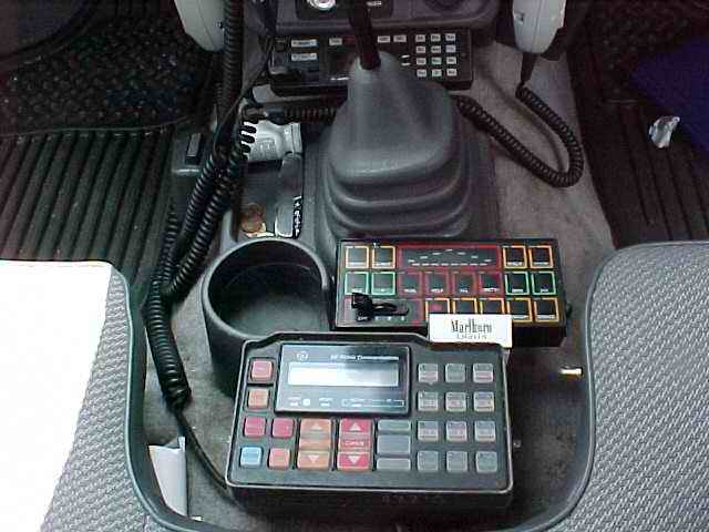 KF6AJM Mobile Shack, UHF radio, Federal Signal controller and GE Lowband radio
